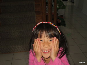 Oh, and some random cuteness.  She made this headband out of pipe cleaners.