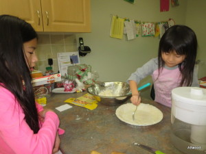 Girls even started to help.  A special thank you to the person who shared that rolling out the pastry in between parchment paper makes all of the difference.  It rolled beautifully and baked up just as nicely.
