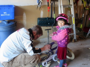 Helping Baba get her new bike road ready.