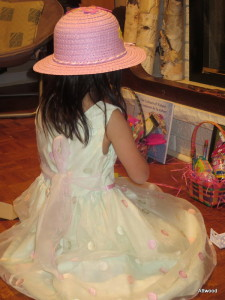 Elspeth got dolled up for baskets and egg hunt complete with an Easter bonnet.