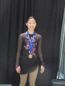 A bronze medal in her new dress.