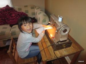 Using her Great-Nana's sewing machine.
